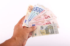 Hand holding euro banknotes Stock Photo