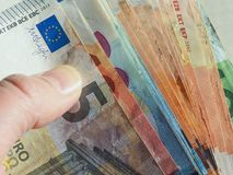 Euro notes, European Union. Hand holding Euro banknotes money (EUR), currency of European Union Royalty Free Stock Images