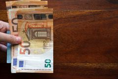 Hand holding euro banknotes stock photography