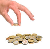 Hand holding euro coin. And pile of coins Royalty Free Stock Photos