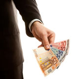Hand holding euro currency Stock Images