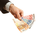 Hand holding euro currency Royalty Free Stock Photos