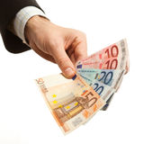 Hand holding euro currency Stock Photos