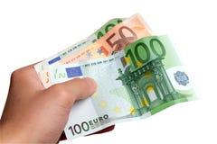 Hand holding euro money. Shot of male hand holding euro money banknotes isolated on white background Stock Photos
