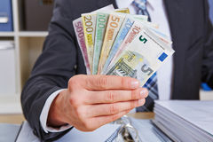 Hand holding Euro money bills Royalty Free Stock Photography
