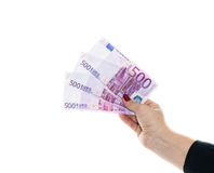 Hand holding 500 euro money isolated on white background Stock Photo