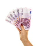 Hand holding 500 euro money on white background Stock Images