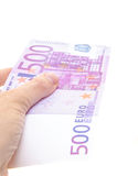 Hand holding 500 euro note Royalty Free Stock Images