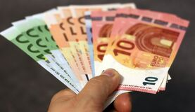 Hand holding Euro notes Stock Images
