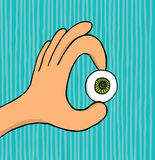Hand holding an eye Royalty Free Stock Photos