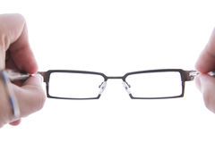 Hand holding eye glasses Royalty Free Stock Images