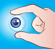 Hand holding eyeball Royalty Free Stock Images