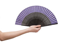 The hand holding fan isolated on white background Royalty Free Stock Photography