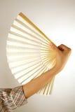 Hand holding fan Stock Photos