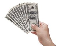 Hand holding fan 100 usa us dollars isolated. Hand holding fan 100 usa or us dollars isolated Stock Image
