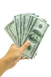 Hand holding a fanned fistful of dollar bills Royalty Free Stock Images