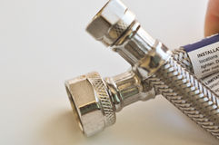 Hand holding faucet connector Royalty Free Stock Images