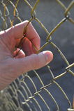 Hand holding fence Royalty Free Stock Photography