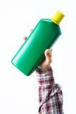 Hand holding a fertilizer bottle Stock Photography
