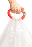 Hand holding few plastic bags with a bag handle Royalty Free Stock Images