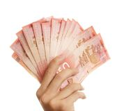 Hand Holding Fifties. A hand holding lots of fifty dollar bills Royalty Free Stock Photo