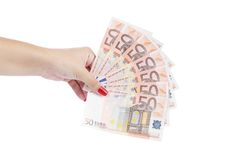Hand holding fifty-euro notes Stock Photos