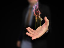 Hand holding fire. Business man hand holding fire Stock Photography