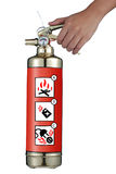 Hand holding fire extinguisher. A hand holding the handle of the fire extinguisher Royalty Free Stock Photos