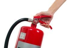 Hand holding fire extinguisher isolated white background. Stock Image