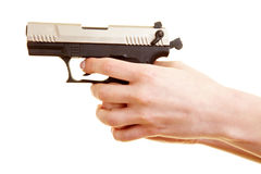 Hand holding firearm Stock Photos