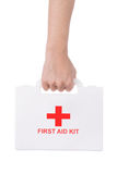 Hand holding a first aid kit Stock Photos
