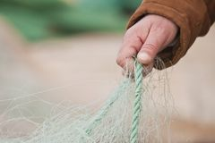 Hand holding fishing Stock Images