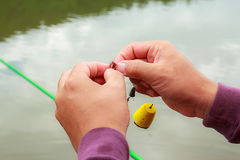 Hand holding Fishing line Stock Photos