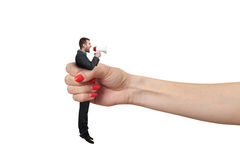 Hand holding in fist small man Royalty Free Stock Image