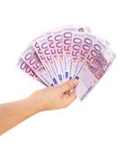 Hand holding five hundred-euro notes. On a white background Stock Photo