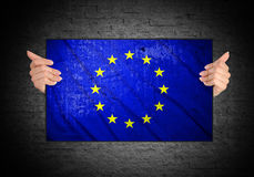 Hand holding flag of European Union. Hand holding grunge flag of European Union Royalty Free Stock Photography