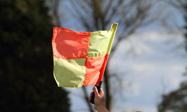 Hand holding a flag at a sporting event Royalty Free Stock Photography