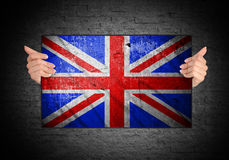Hand holding flag of United Kingdom Stock Photography