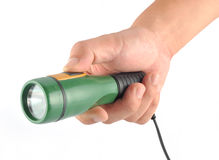 Hand holding a Flashlight Royalty Free Stock Images