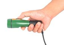 Hand holding a Flashlight stock image