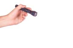 Hand holding a flashlight Royalty Free Stock Image