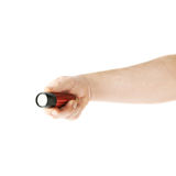 Hand holding a flashlight torch, composition isolated over the white background Royalty Free Stock Image