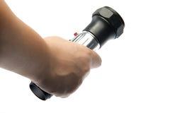 Hand holding flashlight Stock Images