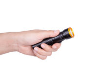 Hand holding flashlight on white background Royalty Free Stock Image