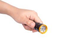 Hand holding flashlight on white background Royalty Free Stock Photo