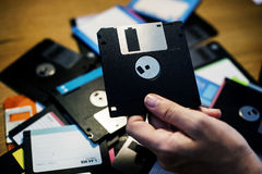 Hand holding floppy disk drive data storage Royalty Free Stock Images