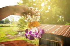 Hand holding flower garland stock photos