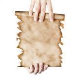 Hand holding a folded roll of old paper Stock Photo