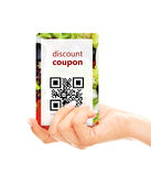 Hand holding food discount coupon with qr code isolated over whi Stock Image
