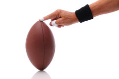 Hand holding a football ready for kicking royalty free stock photos